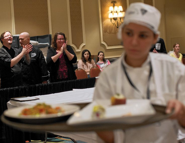2015 ProStart Culinary Team Competition  Parents including Heather Dombkowski, back right, applaud the team from Bayside high School out of Palm Bay, FL as they carry off their finished and prepared meal under the time limit during competition at the 2015 ProStart Culinary Team Competition at the Rosen Plaza Hotel in Orlando on...  http://www.orlandosentinel.com/features/education/os-culinary-arts-competition-20150228-story.html#page=1&lightbox=82944564