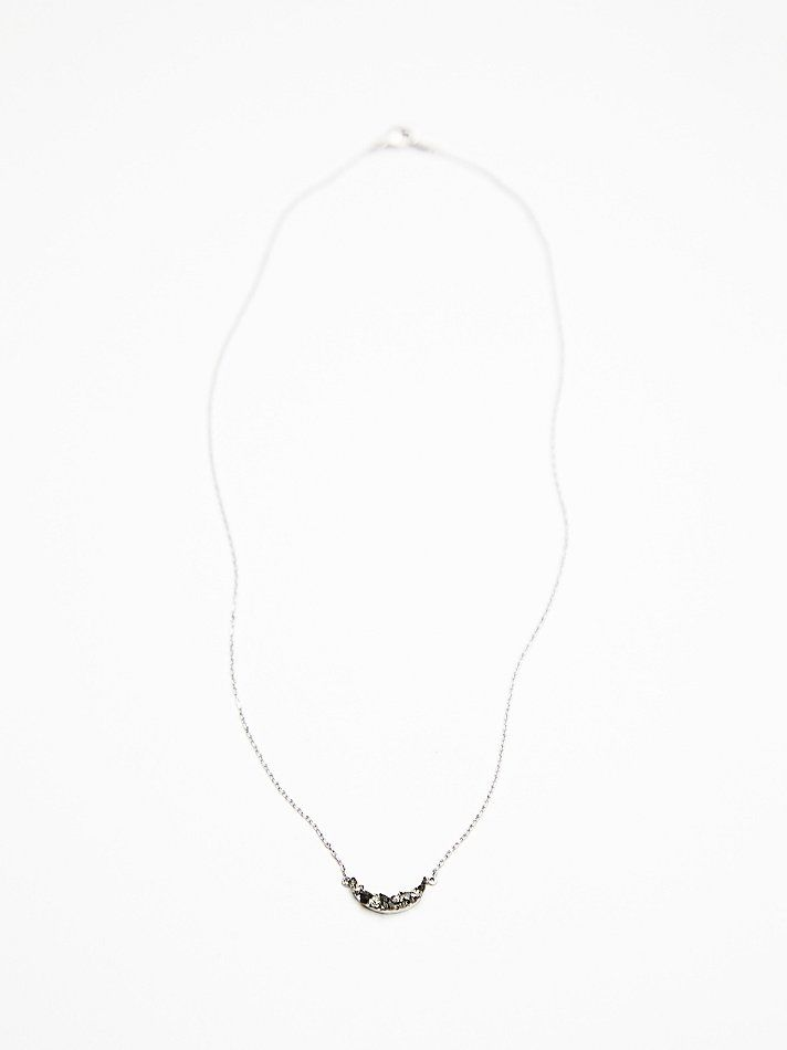 Marly Moretti Tiny Crescent Necklace at Free People Clothing Boutique