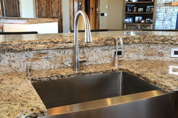 thin stone veneer installed as a backsplash easy to put