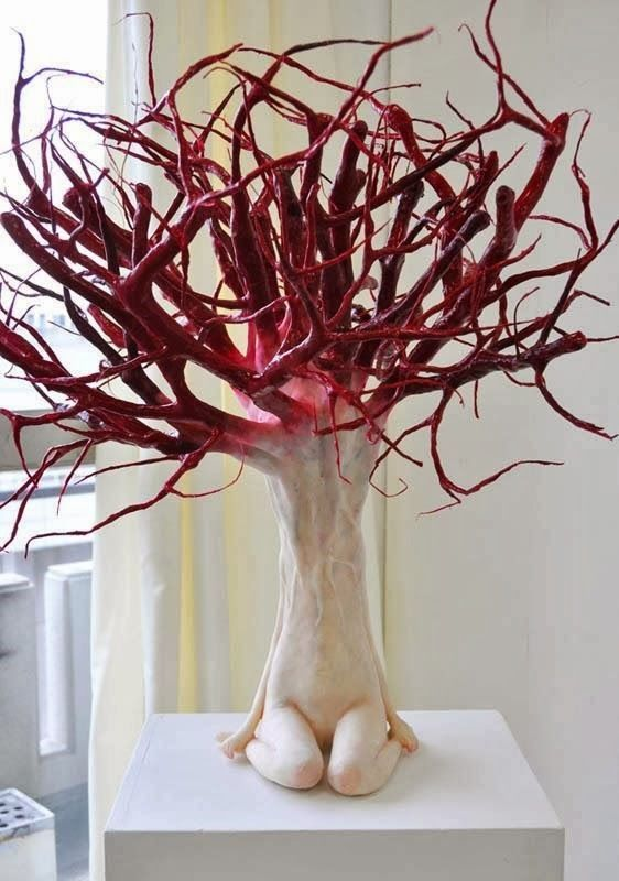 Tokyo-based artist Ishibashi Yui's sculptures are unsettling and beautiful. Her figures seem to have submitted to the plants and branches protrudi...
