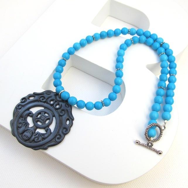 Oriental Daze semi precious turquoise and shell pendant £11.50