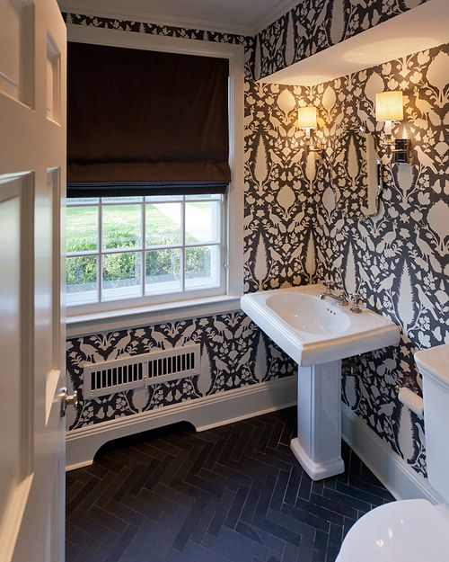 Bold black and white patterned wallpaper in this powder room design   Anne Chessin Design