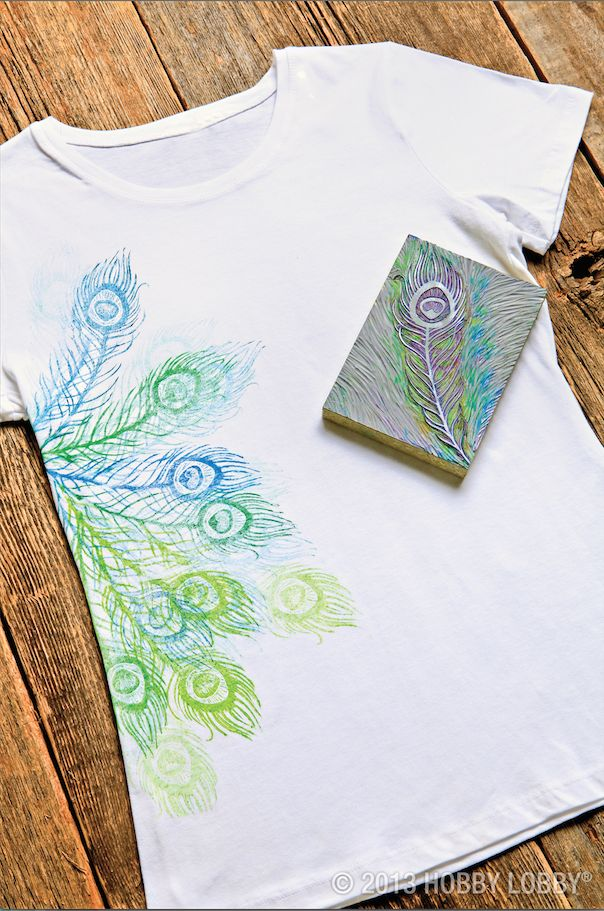 Strut your stuff in this block printed peacock tee! Just trace your design onto a mounted linoleum block before carving and stamping. For this fabulously feathered look, we traded our block printing ink for acrylic paint mixed with fabric medium. We used a light coat of paint for the background feathers and a heavier coat for the ones up front!
