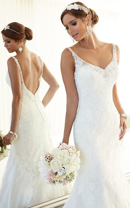 This blissful wedding dress from the Essense of Australia collection features eye-catching Diamante beading along its plunging V-neck and back for Mira Bridal Couture www.mirabridal.com