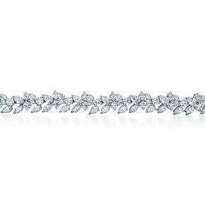 Bracciale a grappolo con diamanti tondi taglio brillante, goccia e marquise.