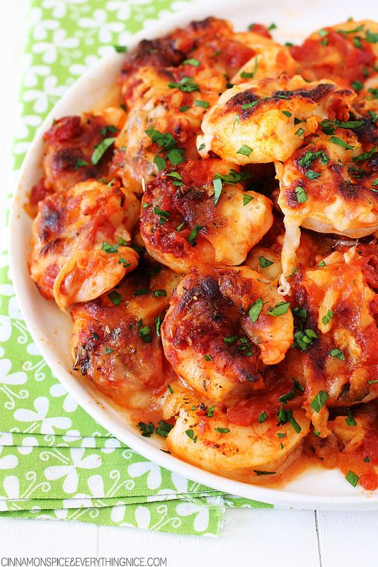 Baked Shrimp Parmesan  -  large shrimp smothered in spicy tomato sauce, mozzarella and parmesan cheese are drizzled with olive oil and baked.