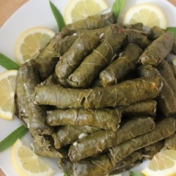 I really love these ;o) Stuffed grape leaves - They are known as both Sarma and Dolma.