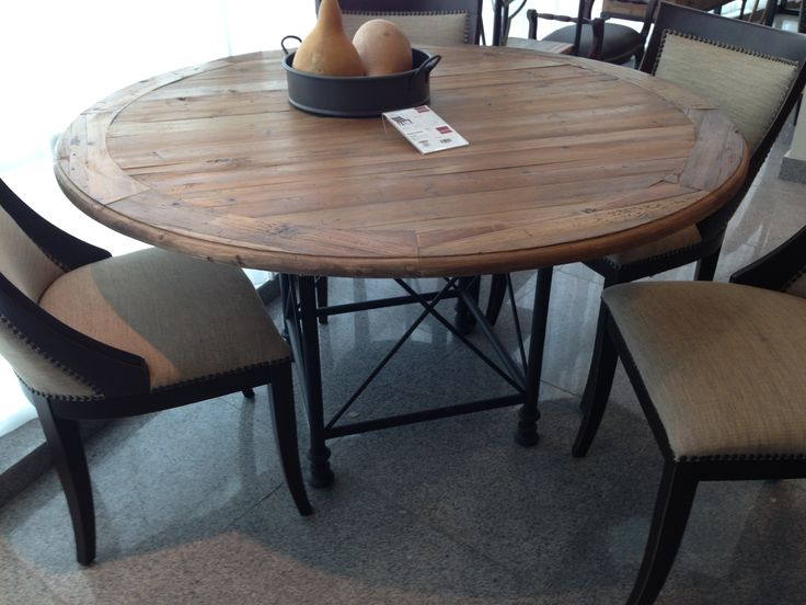 "Don't you just love a round dining table ? Old pine table 55"" with steel base construction. www.nestinghabits.ca"