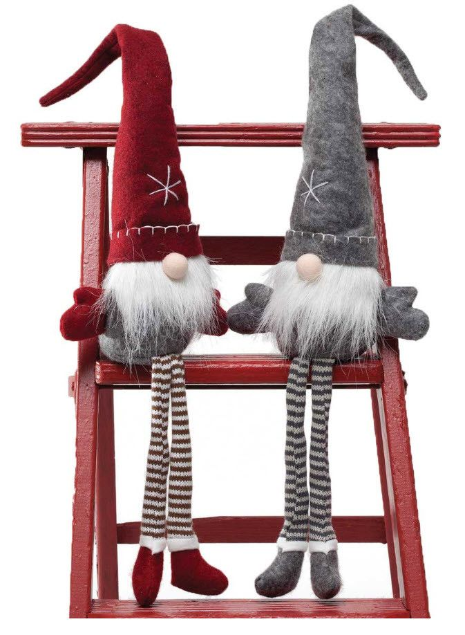 "The gnomes have come to town ready to accent your Christmas decor. These can sit on any shelf or nestle in a little space to add some whimsy. Available in grey/white or red/grey/white. Measures 26""."