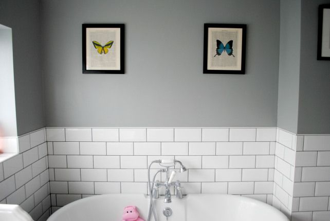 Grey bathroom with roll top bath and subway tiles on The Spirited Puddle Jumper Blog #bathrooms #interiors