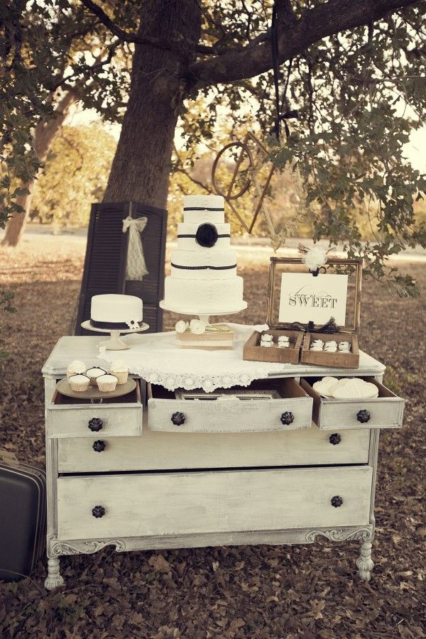 #astylecollective Houston Event Design & Vintage Prop Styling firm. White distressed shabby chic dresser hutch, Dessert sweet table, Vintage wedding decor, Lace Ruffle Cake. Black and white wedding ideas. www.astylecollective.com    This is so darling!