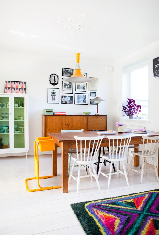 Love this Swedish home with it's relaxed and colourful dining area.