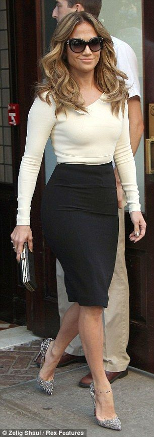 Business chic: J Lo looked fabulous in her pencil skirt and sparkly shoes as she left her hotel