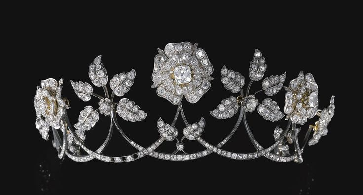PROPERTY OF AN ITALIAN PRINCELY FAMILY Diamond tiara, late 19th century Designed as a graduated series of swags each surmounted alternatively with floral and foliate motifs, set with cushion-shaped, circular-cut and rose diamonds.
