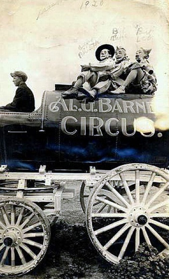 Bert Leo on Al Barnes' Circus Wagon - USA, 1920