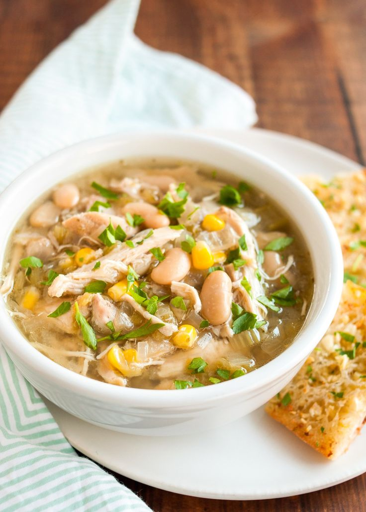This is a hearty chicken stew in the Crock pot with white beans, Southwest spices like cumin and coriander, and a few cans of fire-roasted green chilis.