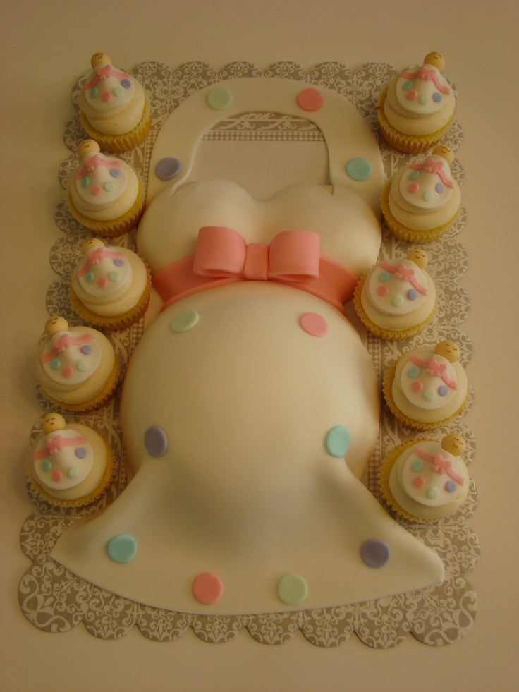 Baby bump cake and sleeping baby cupcakes