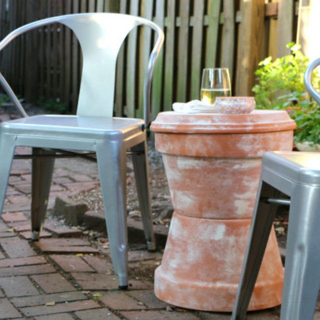 make this outdoor accent table using garden planters plus a trick for weathering terra cotta pots