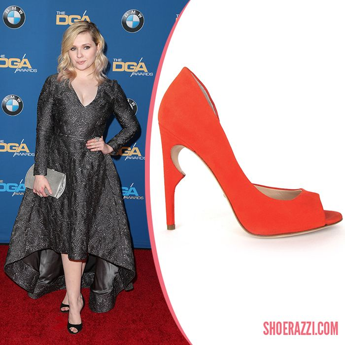 Abigail Breslin wore Jerome C. Rousseau Bryant pumps to the 2016 Directors Guild of America Awards held at the Hyatt Regency Century Plaza in LA. These half d'Orsay peep-toe pumps feature black suede (featured above in poppy suede) with a 110mm thorn stiletto heel.