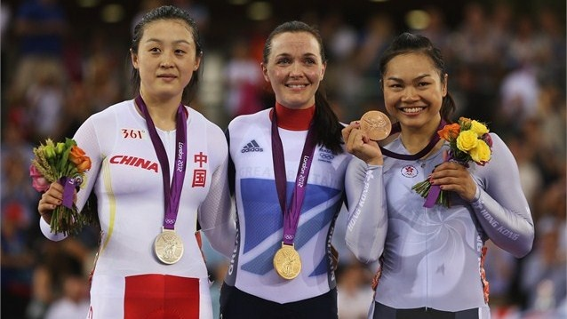 (L-R) Silver medallist Shuang Guo of China , gold medallist Victoria Pendleton of Great Britain and bronze medallist Wai Sze Lee of Hong Kong, China celebrate with their medals during the medal ceremony for the women's Keirin Track Cycling final on Day 7 of the London 2012 Olympic Games at the Velodrome