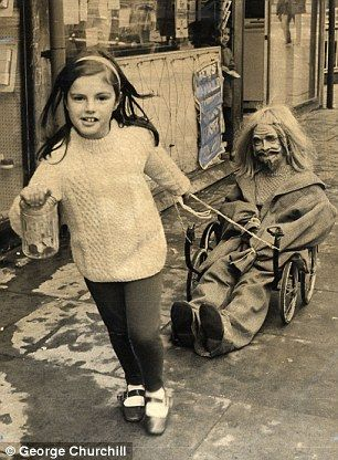 Laura Dale, seven, from Hampstead, pulls a pram chassis with a guy collecting for Bonfire Night in 1970