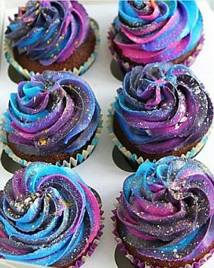 Milky way: Cupcakes have also been made into mini-galaxies using colourful icing