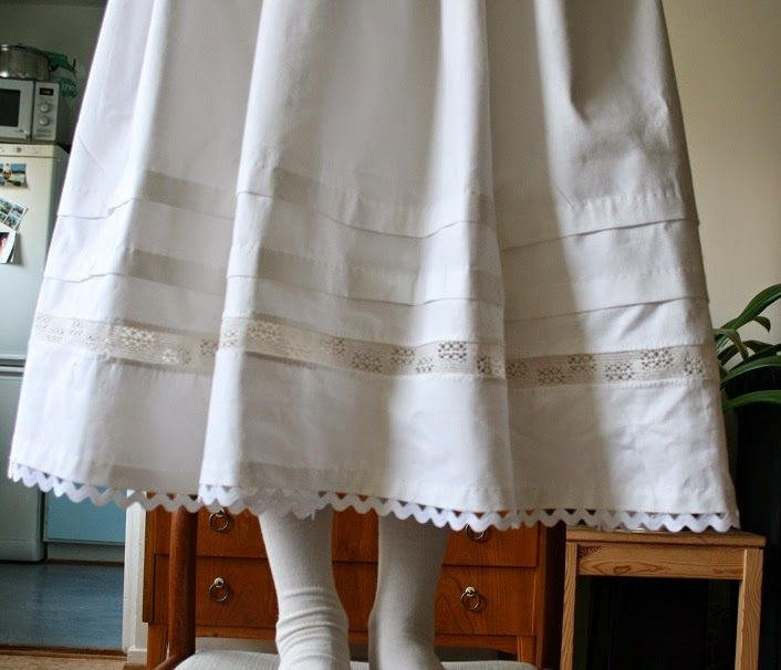 Details 1840 petticoat Rick rack braid, lace insertion, and two tucks.