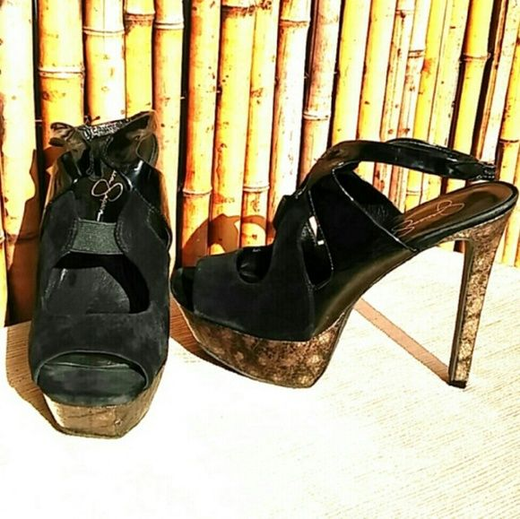 "Black Suede with Metalic Snake print Platform! Black Suede & Patent leather with Metallic Snakeprint Platform Heels by Jessica Simpson. Only worn twice EUC, elastic on top makes this shoe an easy fit and super comfortable! Heel is 5 1/2"" high.  🚫No Trades 🙄😘  🔘Use OFFER button to negotiate👍🤑 🔘Please Ask ❓'s BEFORE you Buy🤔😃 💕Thank you for stopping by! Happy Poshing!💕 Jessica Simpson Shoes Sandals"