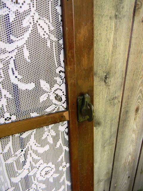 Old screen door with lace panels instead of screen. - Wallmarks: DECOR & FURNISHINGS SHOP