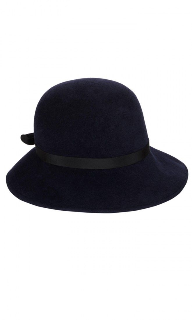 "Jennifer Ouellette navy fur felt Madonna hat.Round velour hat, black grosgrain ribbon. 3.5"" brim , approximately. Grosgrain sweatband at interior. Available in Navy. Rabbit fur felt. Made in U.S."