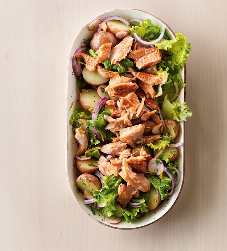 Smoked trout transforms this spring-fresh potato salad into a filling meal. Look for it in the refrigerated seafood section of your supermarket, or alongside cured meats. Serve with crusty bread.