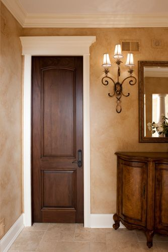 Interior Doors | dark stained wood door with an oil rubbed bronze handle and white topper | Bayer Built Woodworks