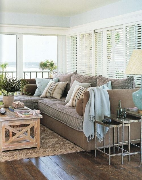 Yummy color scheme that reads relaxed coastal without scream I want a Beach Themed Room!!! Ahhh, loving that soft blue with the sandy couch.