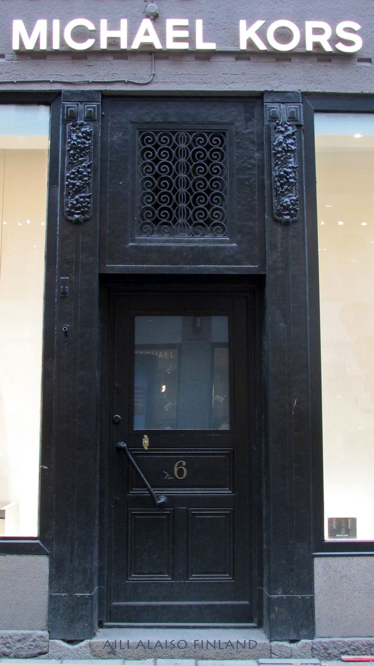 Black door to Michael Kors boutique , Stockholm Swerige by Aili Alaiso Finland