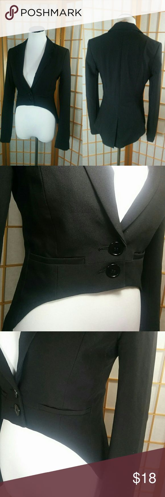 """H&M Divided women's tuxedo jacket Hi&M Divided, women's high low tuxedo jacket with leopard print lining. Tag says size 6 but this runs small and would likely better fit a size XS or 2. (I usually wear a 2/4 and it's too small for me). Measures 14"""" across the waist when laid flat and 16"""" from armpit to armpit. Divided Jackets & Coats Blazers"""
