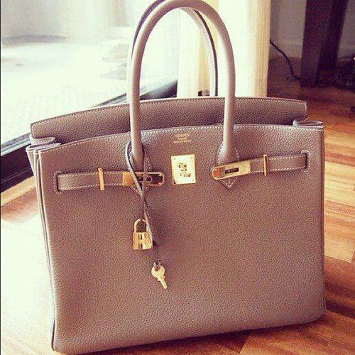Hermes Birkin! Would love in any neutral color, maybe black, beige, camel-ish, chocolate brown? This bag will make me poor haha