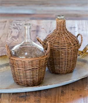 Inspired by a European flea market favorite, our Willow Covered Wine Bottles have a rustic farmhouse quality. Known as demijohns, wicker covered bottles were used in the late 19th century to protect the glass during transport. The antique shape and style of each bottle lends vintage charm to your country home decor.
