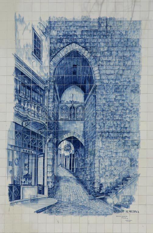 Azulejo of Arco de Almedina in Coimbra. The arch is a relic of the Moorish town walls