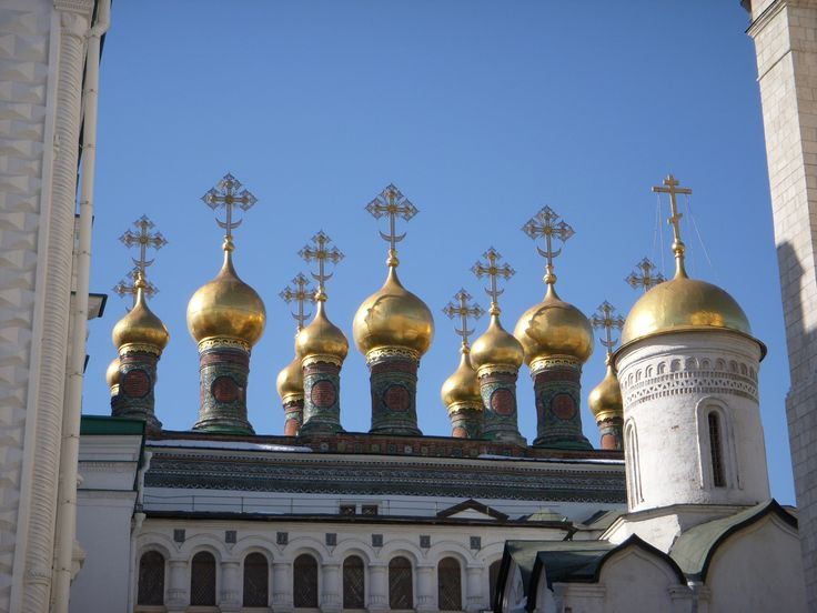 "This glittering array of golden onion domes and crosses adorns the top of the ""Church of the Deposition of the Robe of the Holy Virgin."""