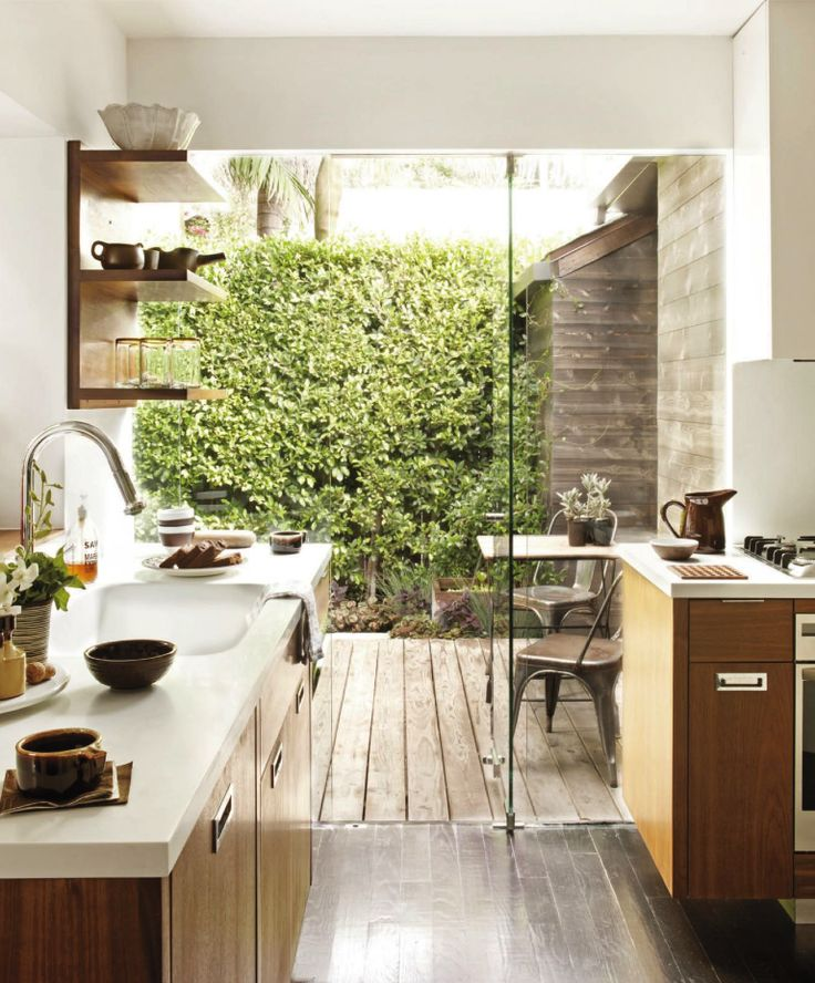 Loving how outdoor spaces are being incorporated into indoor spaces more and more! Like with this kitchen/dining space!