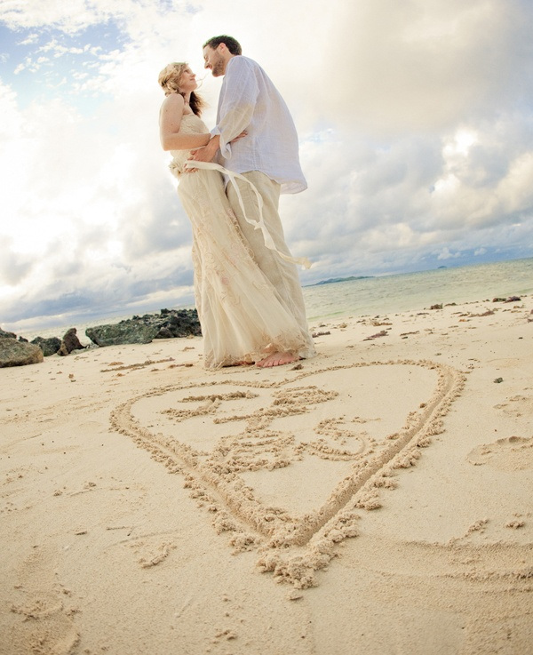 Wedding Poses: Another Writing In The Sand Pose