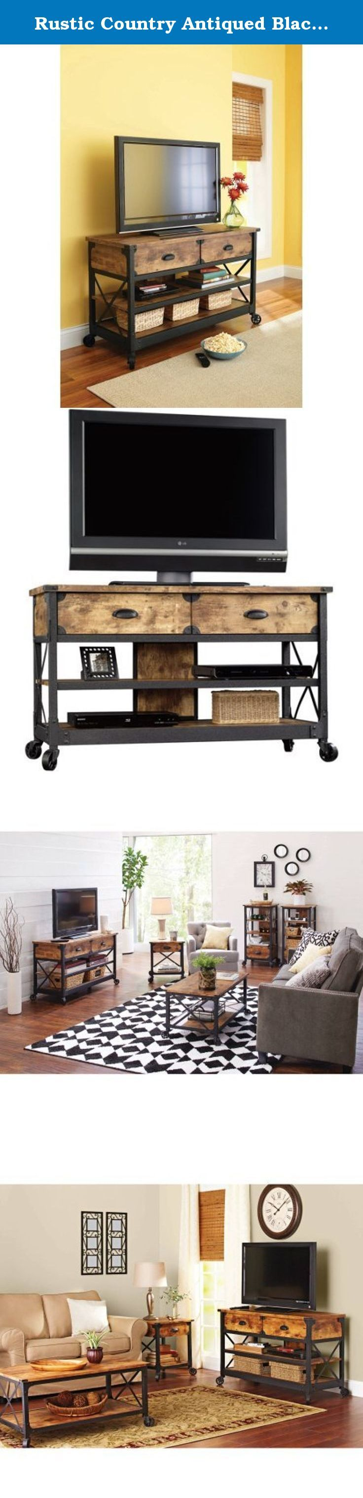 """Rustic Country Antiqued Black/pine Panel Tv Stand for Tvs up to 52"""". This Better Homes and Gardens Rustic Country Panel TV Stand features a warm, distressed-look engineered wood base and antiqued black metal trim which evoke the charm of a well-loved antique. Bring the feeling of a vintage piece sourced in the California Wine country to your living room, den or TV room. With two spacious shelves for storing media components, books, magazines or knick knacks and two drawers for storing…"""