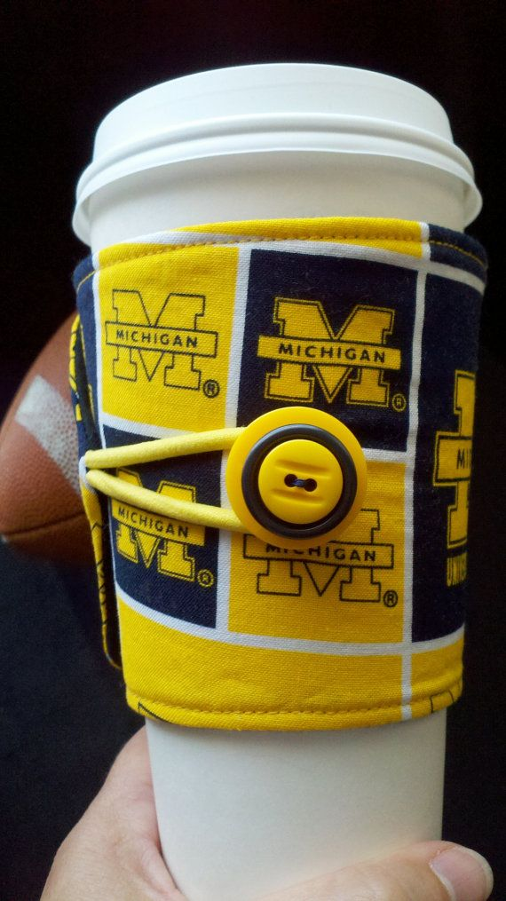University of Michigan  Cup Cozy by ALittleXtraSomething on Etsy, $7.99: for those colder games!