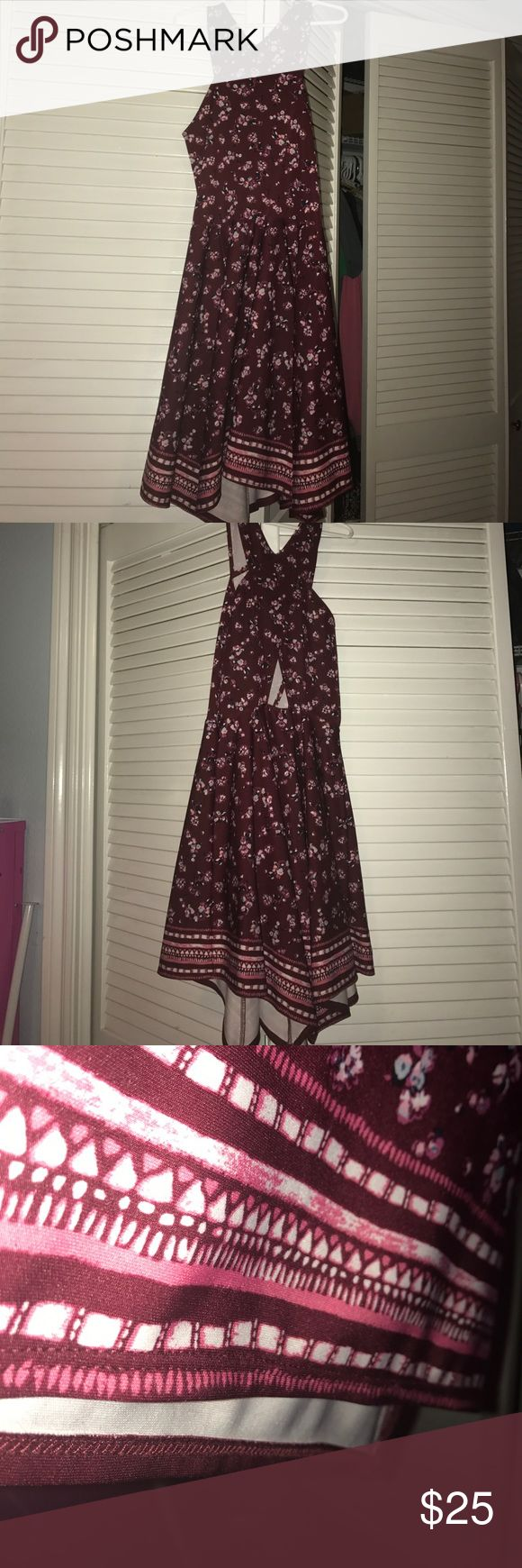 Abercrombie dress M/12 Maroonish/red background with flowers and an Aztec design on the trim. Used but in great condition. abercrombie kids Dresses Mini