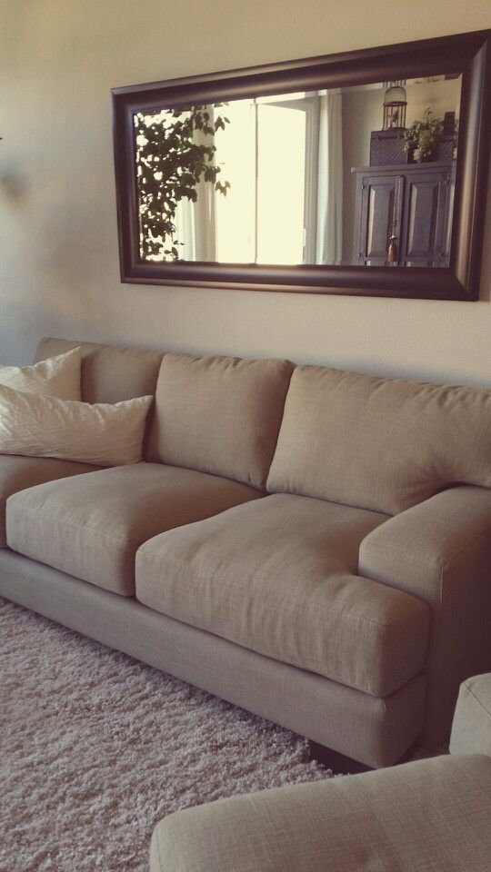 Mirror above couch... make sure it's reflecting something that's nice to look at.