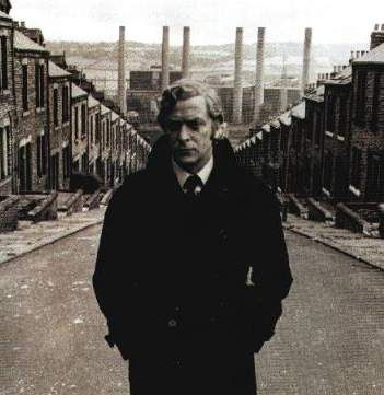 Michael Caine as Jack Carter in Get Carter (1971), directed by Mike Hodges.  Fantastic British gangster / revenge film.