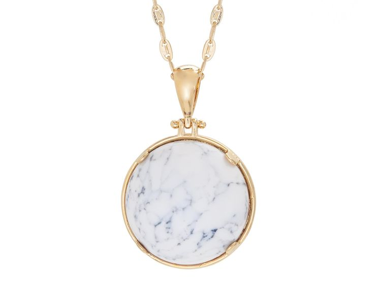 Flip your outfit, flip your mood, flip your pendant. This reversible cabochon necklace has marble ivory on one side and black howlite on the other, set in 14-karat gold plate, hanging from a generous 32-inch chain. It works well as a casual standalone, and it's great for layering with shorter chains.