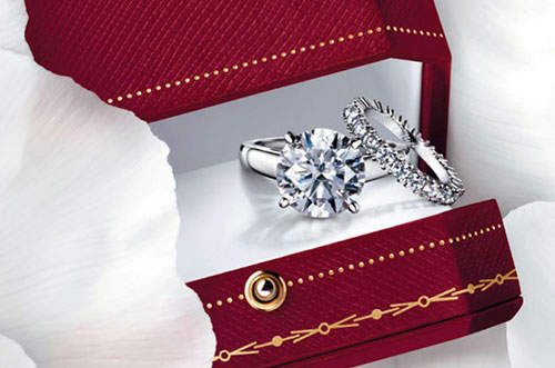 Solitaire Cartier Engagement Ring with Diamond Wrapped Wedding Band, but with a skinny engagement ring band