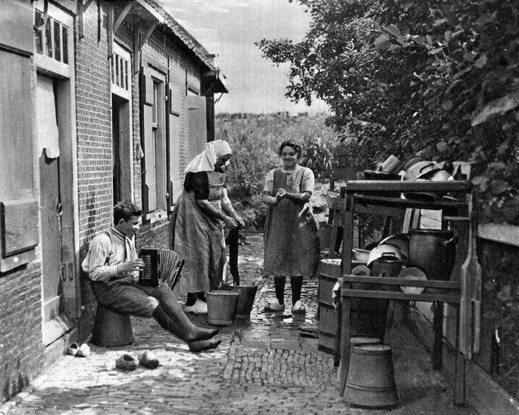 Photo. 1927. Amsterdam. Backyard - Boy Playing Accordion & Women Doing Wash