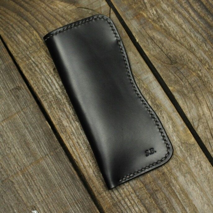 Personalized glasses case in black Italian vegetable tanned leather.
